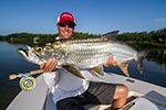 The Capt landing a nice Tarpon caught on the fly rod.